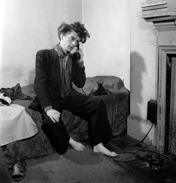 October 1948. English author, actor and artist Quentin Crisp in his scruffy Chelsea flat.